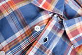 Bright multi-colored plaid shirt with a collar — Stock Photo