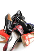 Heap of old female leather footwear on a high heel — Stock Photo