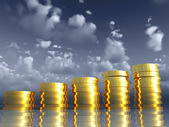 Golden coins on a background of the blue sky — Stock Photo