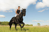 Young man and horse — Stock Photo