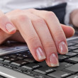 Woman pressing enter key — Stock Photo