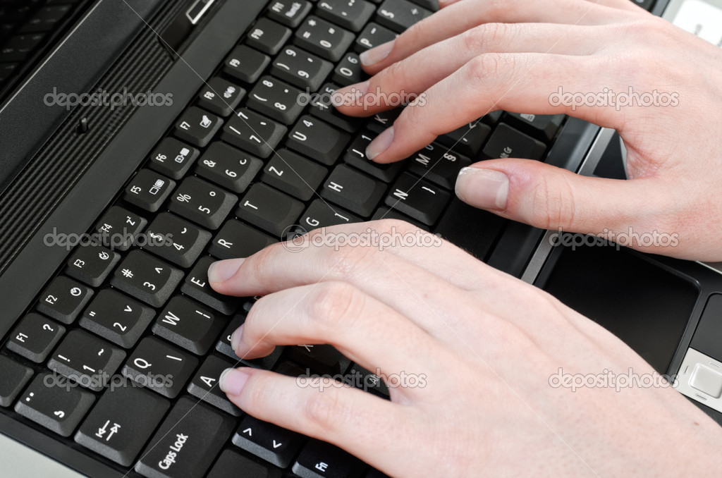Woman pressing keys on the laptop computer keyboard — Stock Photo #9848168