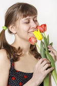 The girl inhales aroma of tulips — Stock Photo