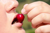 Eating a cherry — Stock Photo