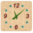 Wooden clock with glass figures and arrows on white background — Stock Photo