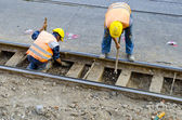 Men restoring railway — Stock Photo