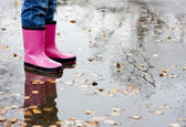 Boots in a puddle — Stock Photo