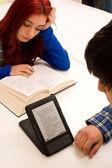 Ebook vs. paper book — Stock Photo