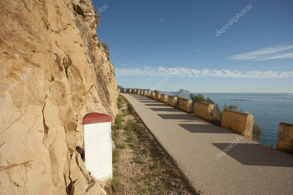 Small paved road running across a sunny landscape  Stock Photo #9802034