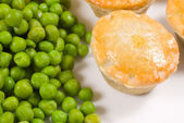 Pies and peas — Stock Photo