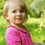 Baby girl outdoor in spring — Stock Photo