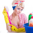 Pinup girl with cleaning set — Stock Photo