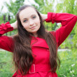 Woman with long hair and red trench — Stock Photo