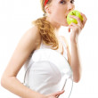 Sporty woman with scale and green apple — Stock Photo