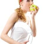 sportowy kobieta z skali i zielone jabłko — Zdjęcie stockowe