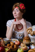 Russian woman drinking tea with samovar — Stock Photo