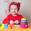 Girl playing at table in nursery — Stock Photo