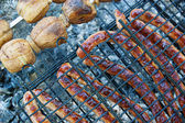 Sausages and potato barbecue — Stock Photo