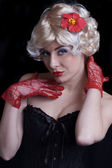 Blond woman in corset with red gloves — Stock Photo