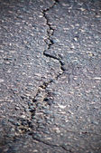 Cracked asphalt — Stock Photo