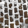 Close up shot of a cobblestone alley in winter time - Stock Photo