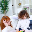 Mother playing with her little daughter — Stock Photo