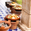 Tajine cooking at restaurant in morocco Africa - Stock Photo