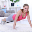 Attractive young female doing push ups — Stock Photo