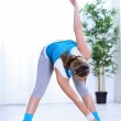 Girl doing stretching exercises — Stock Photo