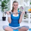 Woman exercising with weights — Stock Photo