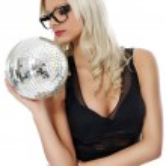 Sensual young woman holding disco ball — Stock Photo