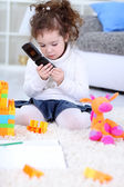 Child playing with mobile phone — Stock Photo