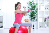Woman in sportswear, doing fitness exercise with dumbbell — Stock Photo