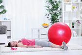 Tired young woman taking rest after exercising — Stock Photo