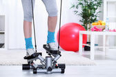 Legs on stepper trainer — Stock Photo