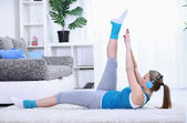 Girl doing abs exercise at home — Stock Photo