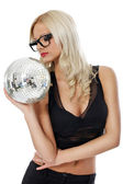 Sensual young woman holding disco ball — Stock Photo