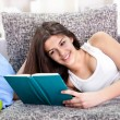 Pretty teen girl reading book — Stock Photo
