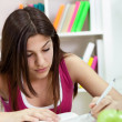 Young student girl writing — Stock Photo #10515775