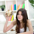 Stock Photo: Girl holding empty piggybank
