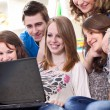Teens students with laptop computer — Stock Photo