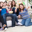 Young laughing and watching TV — Stock Photo