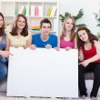 Students with blank sign — Stock Photo