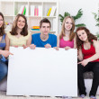 Students with blank sign — Stock Photo #10515908