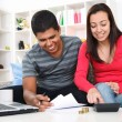 Stock Photo: Couple doing their accounts