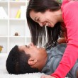 Affectionate cuple at home - Stock Photo