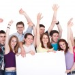 Group of excited friends holding a banner isolated on white — Stock Photo #10516149