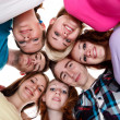 Group of smiling friends with their heads together — Stock Photo