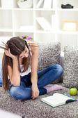 Tired teen girl learning — Stock Photo