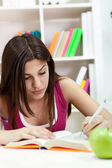 Young student girl writing — Fotografia Stock
